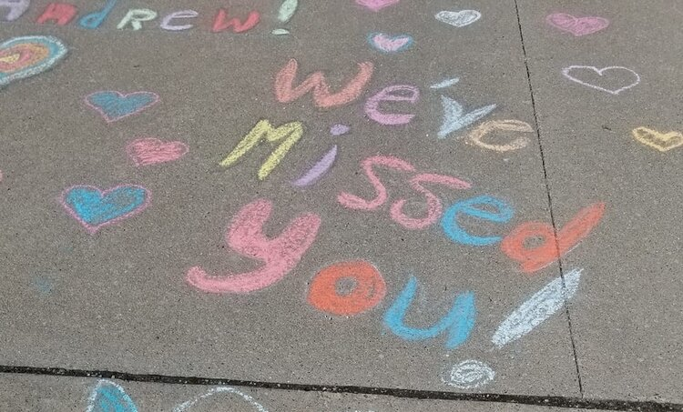 Joanne Weiler-Piechotte drew a message for her grandson in the driveway. The family drove to her home to deliver a mask, but the grandparents couldn't visit them in person.