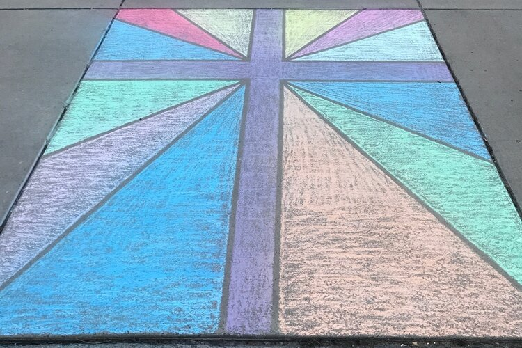 A stained-glass style chalk design on a cross in Midland.