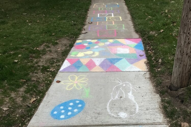 A hopscotch game, bunnies, eggs and colorful patterns greet walkers in Midland.