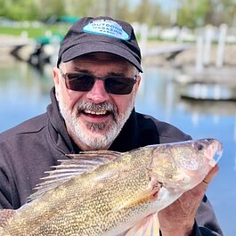 Mike Avery and his catch of the day, a walleye.