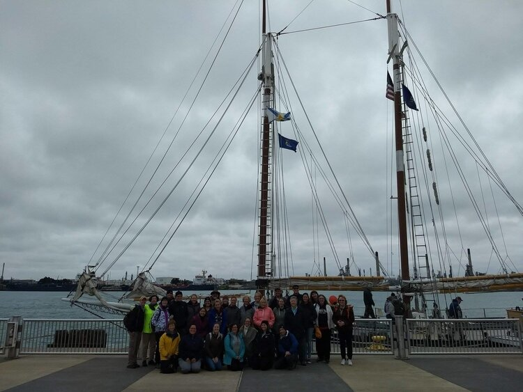 A group of outdoor educators by Appledore IV in Bay City.