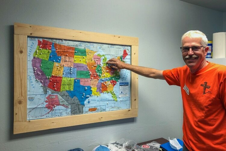 Brian Rueger traveled to Sleep in Heavenly Peace headquarters in Idaho to learn about the organization and its mission. Here, he puts a pin in the map to commemorate forming a chapter in Auburn.