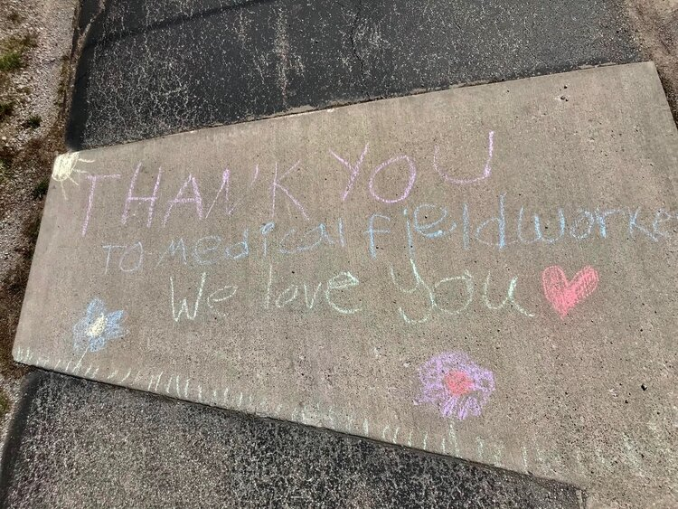 A sidewalk chalk message from Baker's twins made during their time off.