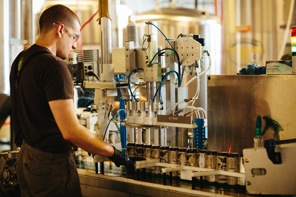 Employee Keith Adams manages the 4-head CO2 purge and 4-head filler section of the canning process.