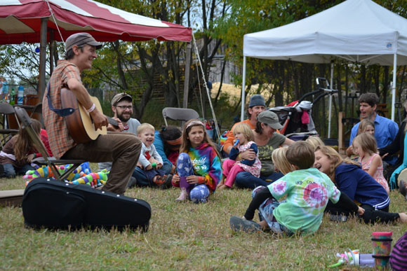 Chris Dorman plays near the kids tent.
