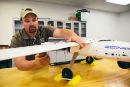 Carl Rocheleau, UAS instructor puts together the Penguin UAV Factory B Model.