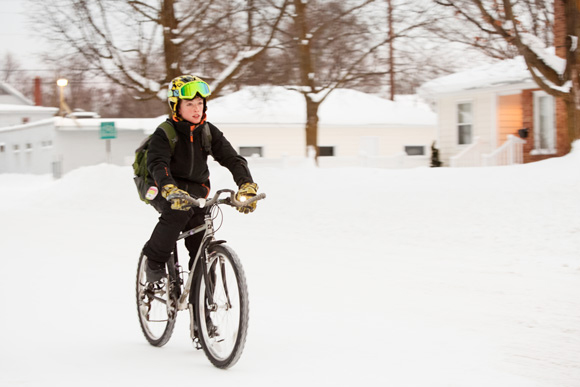 Max Werner bikes his way through the snow. / Beth Price