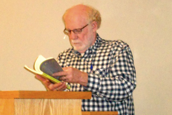 Jack Ridl during a reading. / Barry Matthews