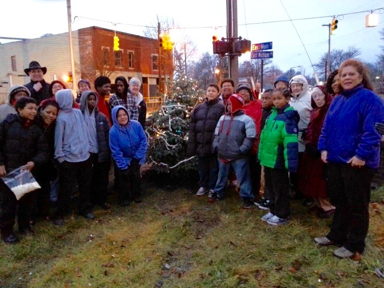 Lowder's Automotive donated a living tree to the Eastside neighborhood, which was decorated by CHAMPS and Peace House youth.