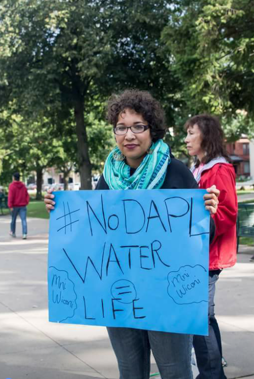 Monica Washington Padula with a No DAPL sign.