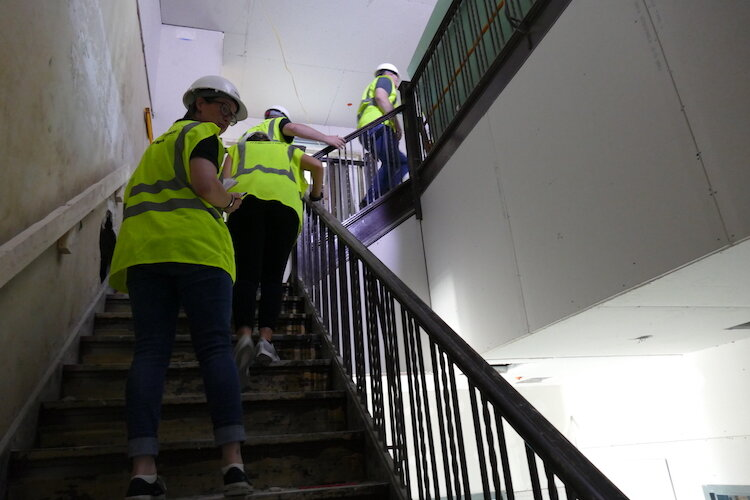 Traveling up the stairs in The Milton as renovations take place.