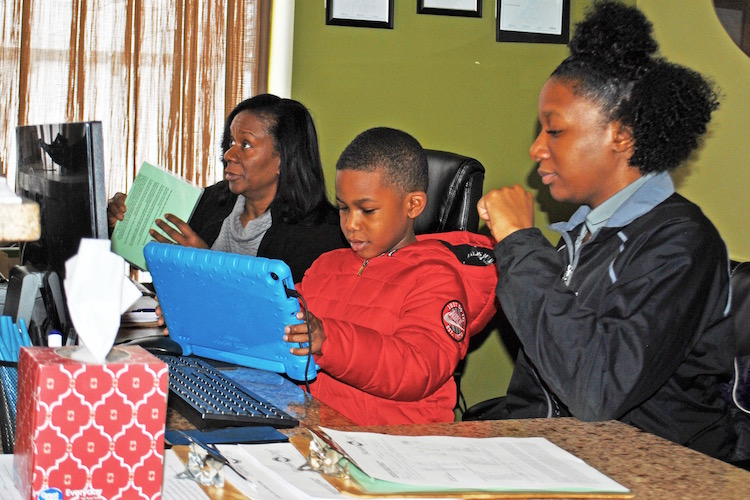 Margaret Kirk, her daughter, Spa Manager, Tyla Wade, and grandson, Arion Eppinger, use their new computer network made possible by a loan from the Small Business Community Loan and Grant Fund.