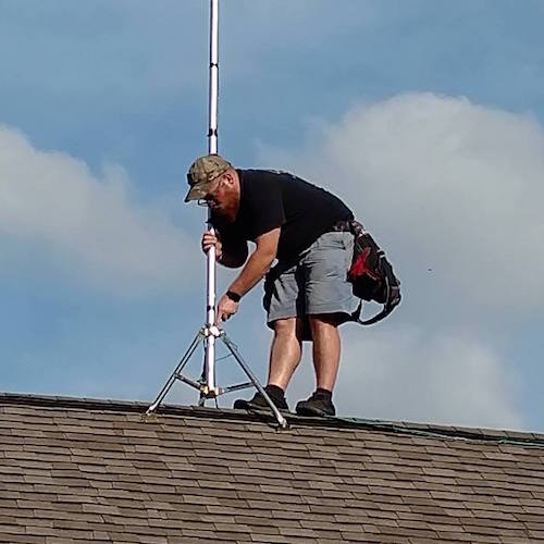 An installer for Aeorn Wireless up on the roof