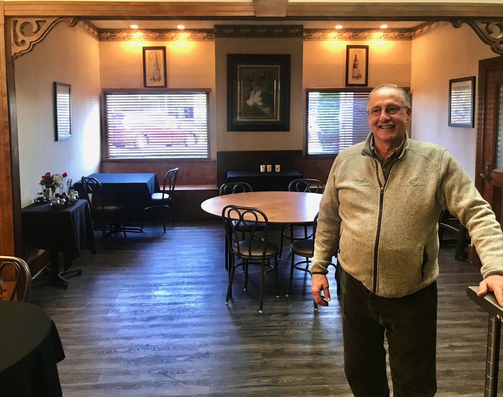 Peter Comensoli stands in a dining and private events room that helped the restaurant space out its customers in order to meet state-mandated social distancing requirements.
