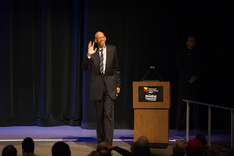 Kareem Abdul-Jabbar says hello to the full house at WMU's Miller Auditorum for the Kalaamazoo Public Library's Reading Together discussion