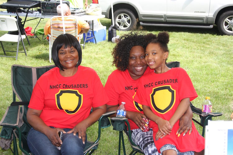 Emjoying the afternoon at a previous Battle Creek Juneteenth celebration.