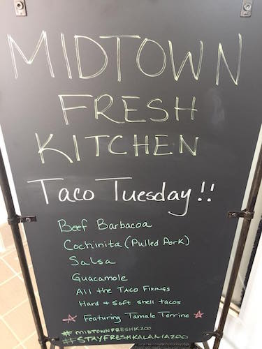 A chef creates meals that change daily at Midtown Fresh.