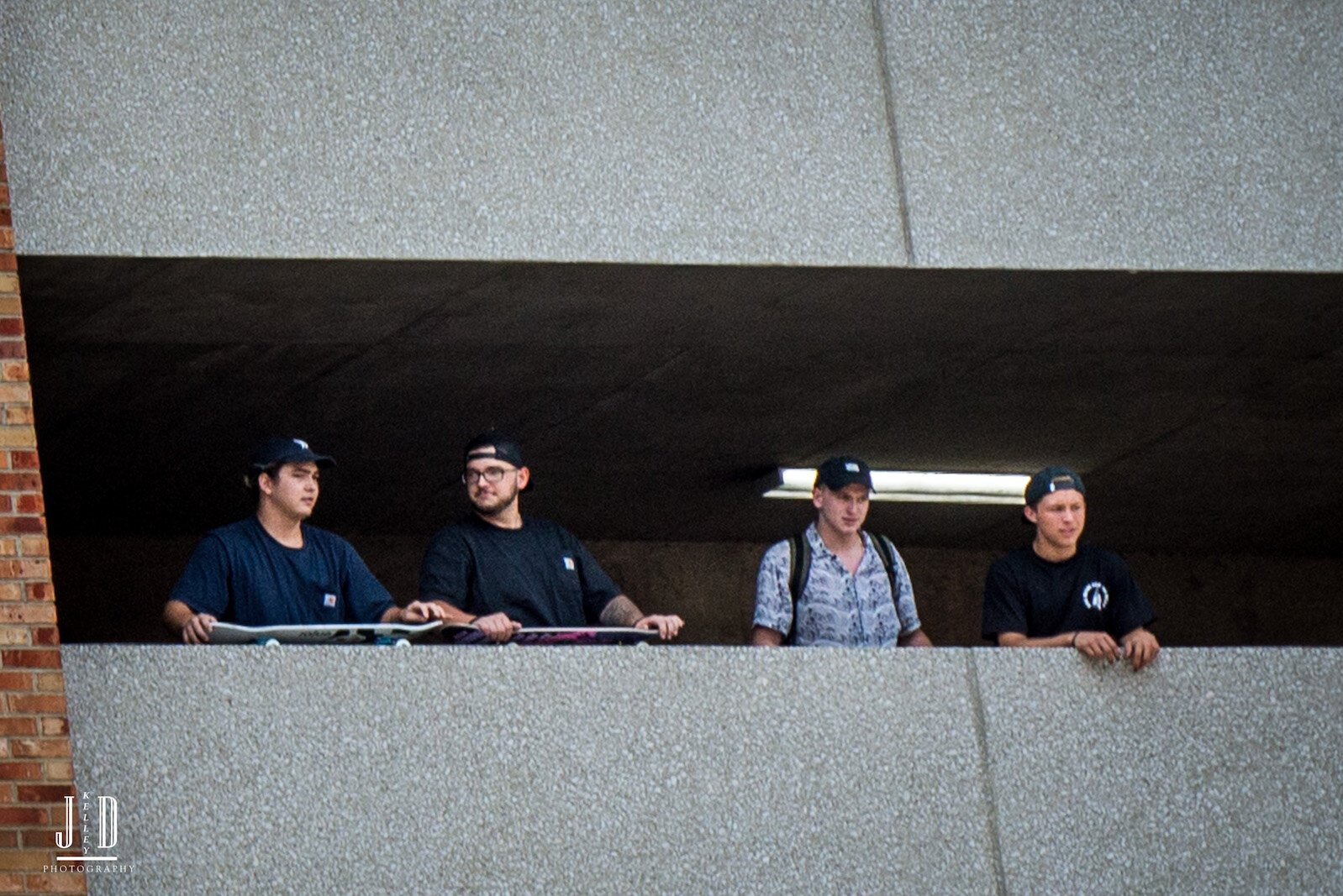 Proud Boys look out from the safety of the Raddison Parking ramp.