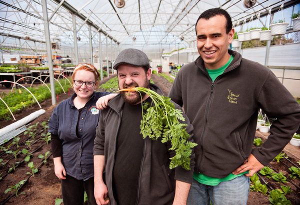 Jeremy Andrews, CEO of Sprout Urban Farms with employees Rebecca Spicer, left, and Devon Gibson, right, inside their greenhouse in Battle Creek, Michigan.
