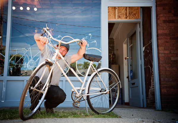 Ryan Barber Ryan Barber Ryan Barber works outside his Bike Shop off ...