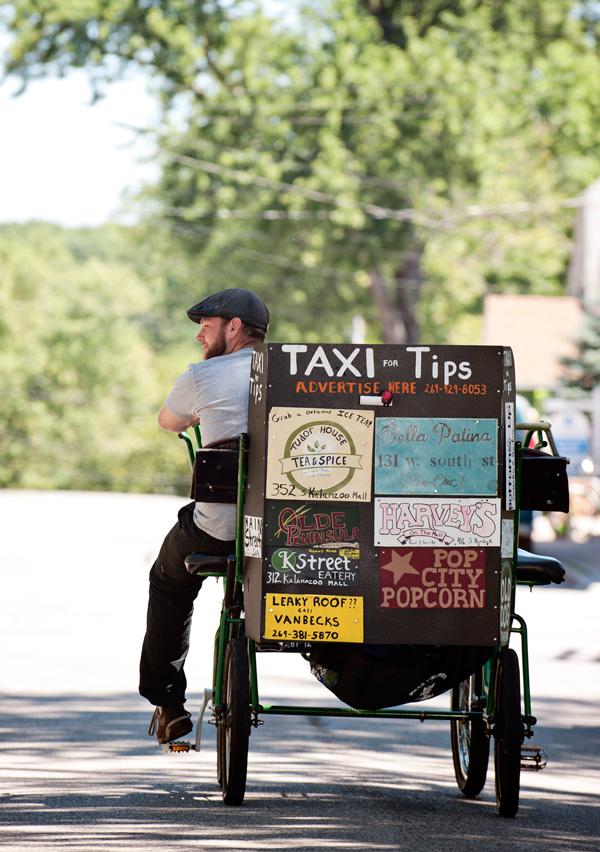 Barber Shop Kalamazoo : Ryan Barber peddles downtown as he pedals through it