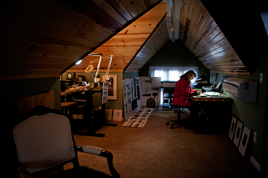 Linda Rzoska, owner of Ninth Wave Studio, works in her upstairs studio.