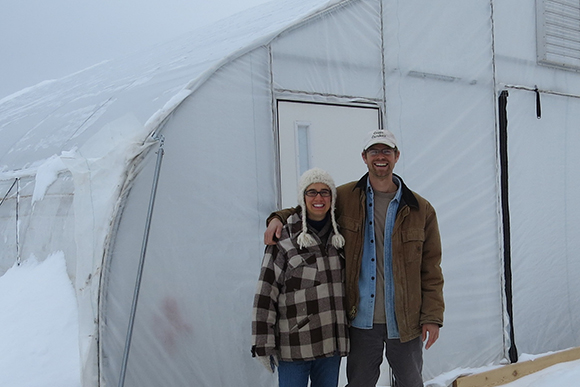 The Thompsons at one of their hoop houses.