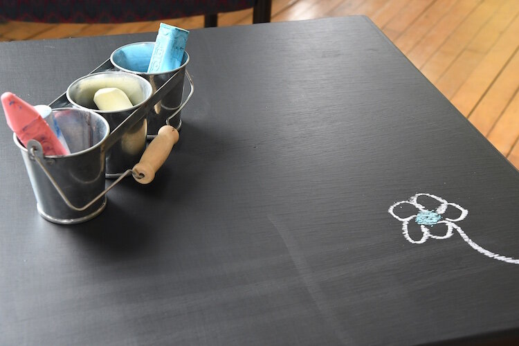 There is a small table with blackboard paint and chalk in A2A's meeting space.