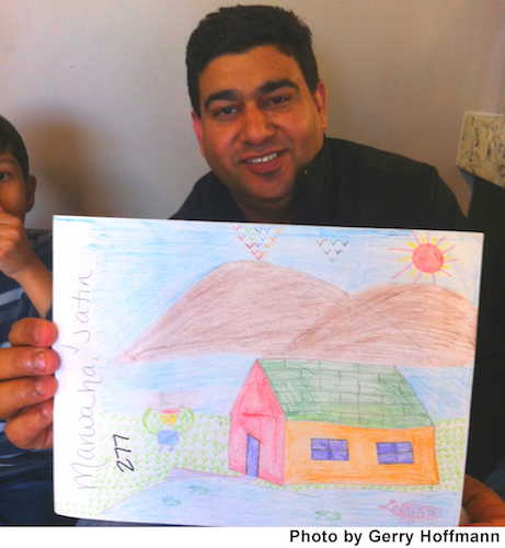Amit Kumar proudly showed off his son's artwork during the Dental Day of Caring.