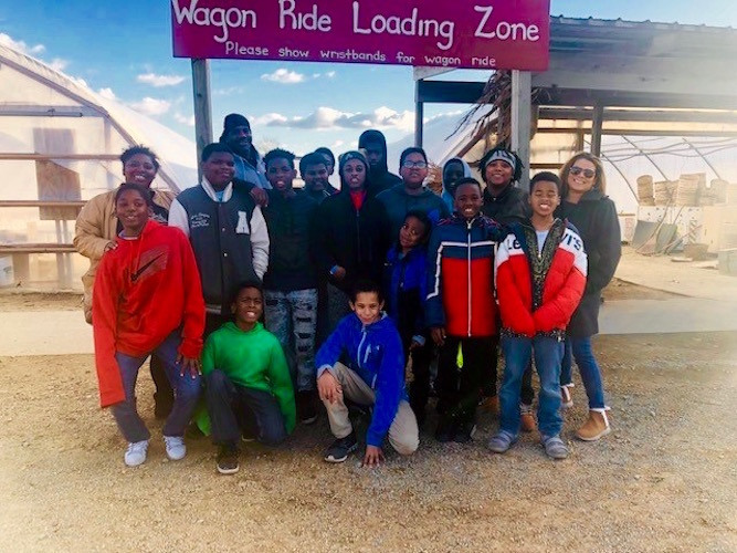 Northside S.T.R.E.E.T. youth and staff visit the apple orchard in October.