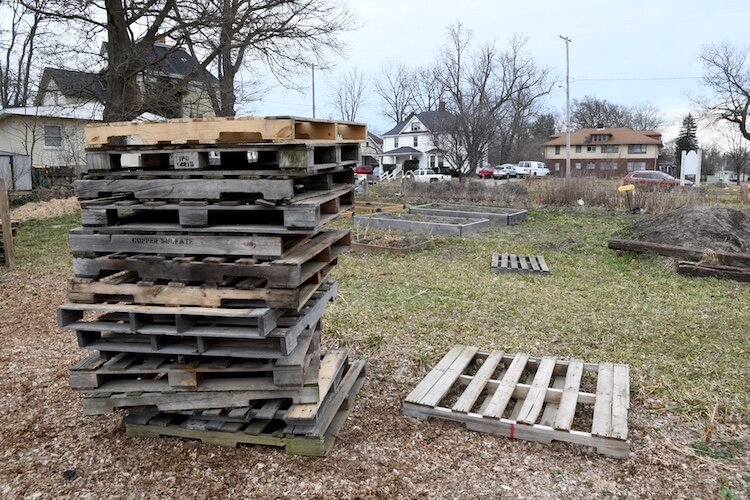 Stacked pallets and raised garden beds at the Fremont Garden