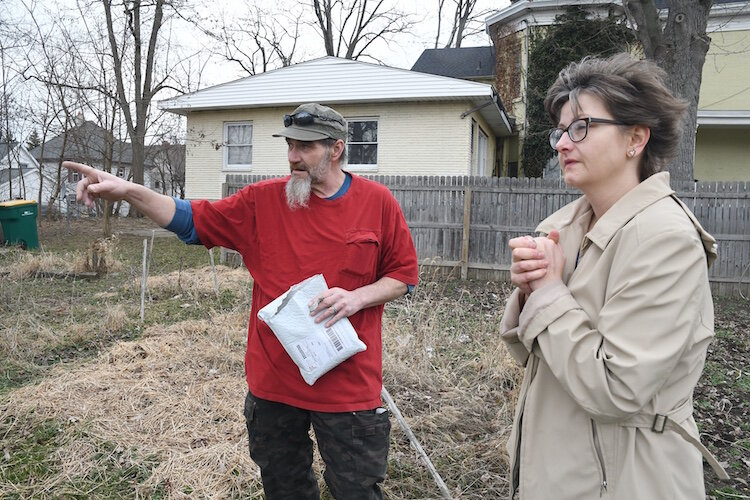 Thomas Hart, main caretaker of the Fremont Garden, and Jackie MacCannell, volunteer, discuss plans for this year's garden.