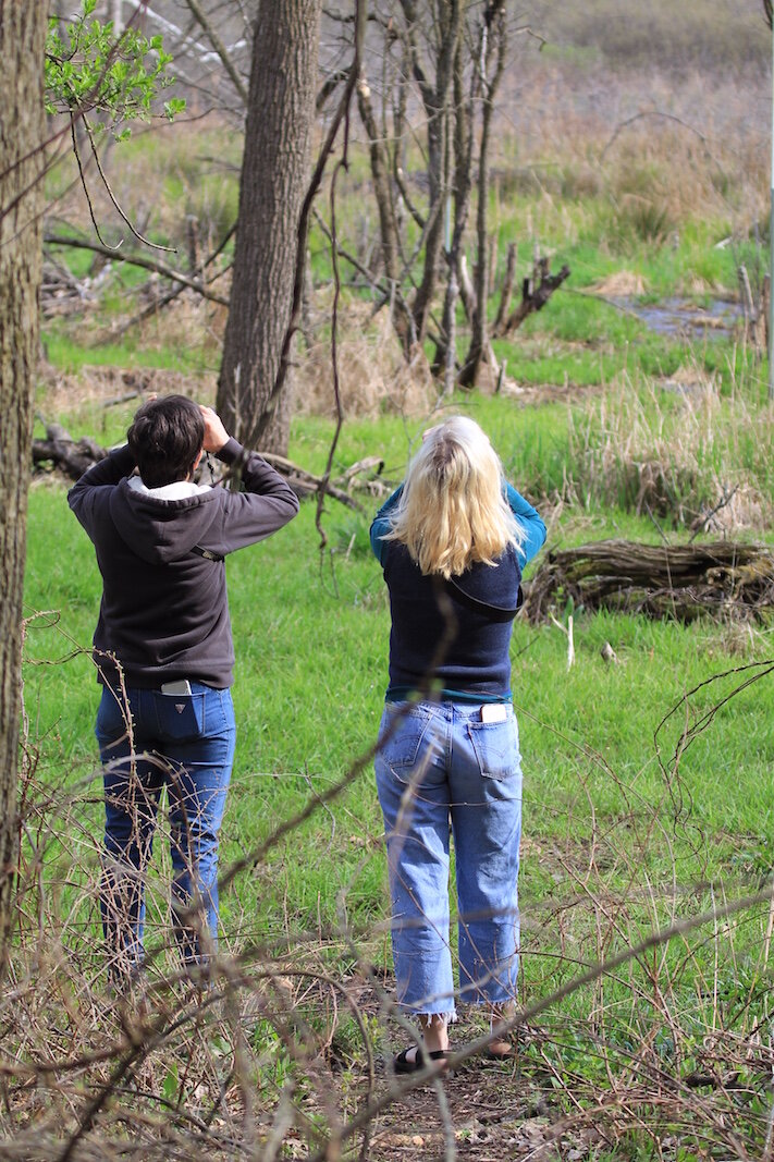 Heather and Molly Ratliff share a moment looking at birds in the Kleinstuck Preserve.