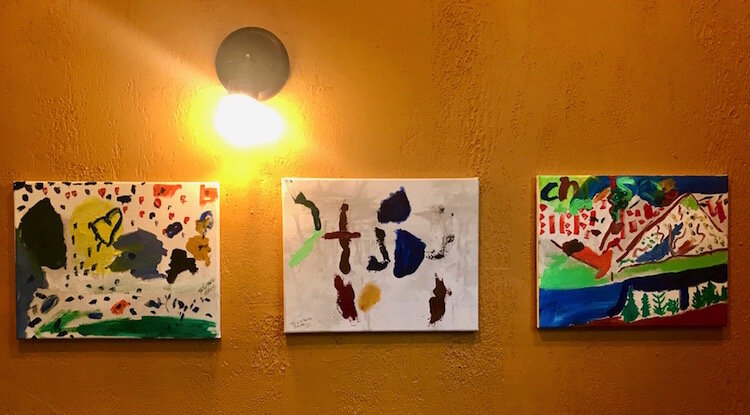 These are three paintings by Kristen McKinney, the 5-year-old daughter of restaurateur Chrissy McKinney.