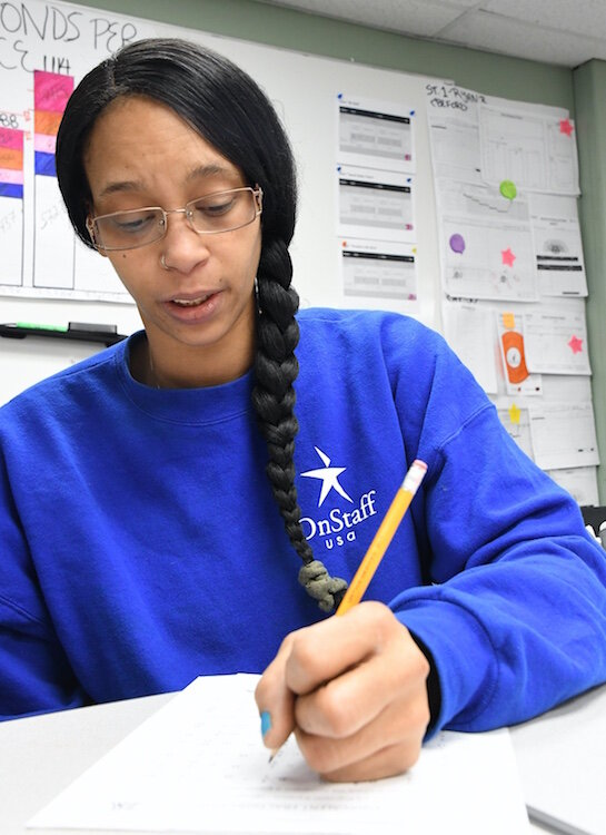 Lilleana Bottom, DENSO employee, is working toward her GED diploma on site at the plant in Ft. Custer.