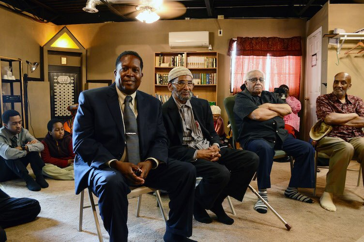 Imam Warithudeen Mohammed II (front-left)  of The Mosque Cares, visiting Bilal Islamic Center before giving a speech at the Douglass Community Association Aug. 10.