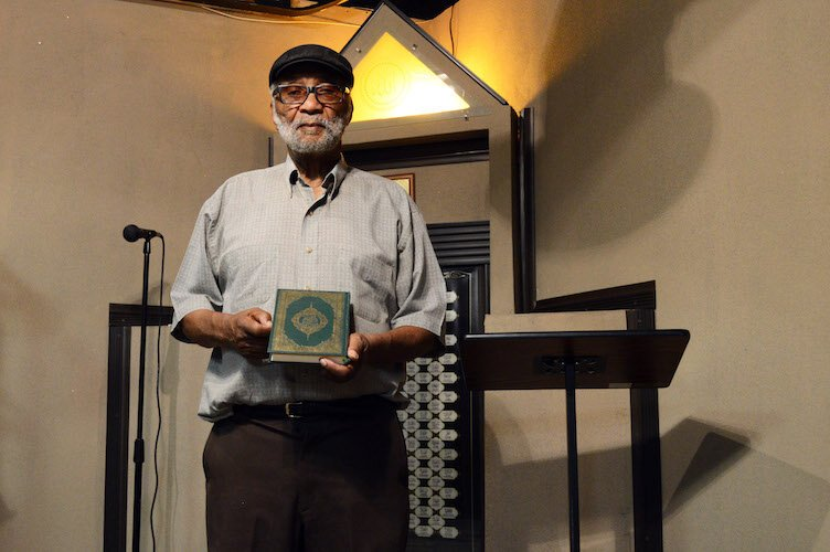 Imam Hassan Mateen, holding his Koran in the mosque of Bilal Islamic Center, Eastside Kalamazoo.