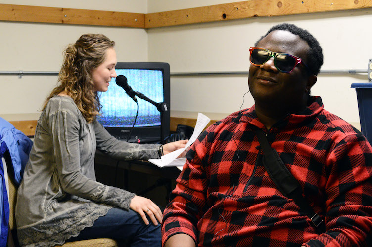 Abby Tongue, grad student at WMU's Department of Blindness and Low Vision Studies, and fiancé Osman Karoma, testing audio description service for Kalamazoo Civic Theatre.