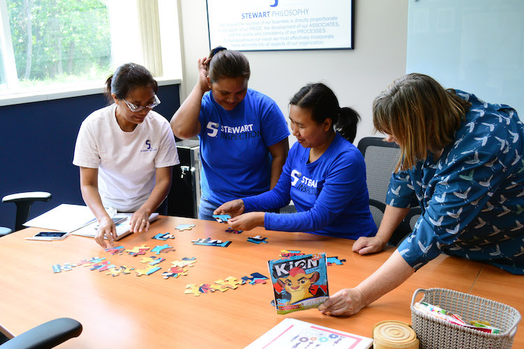 "ESL students learn the words ""corner, edges, interior, exterior"" through a jigsaw puzzle."