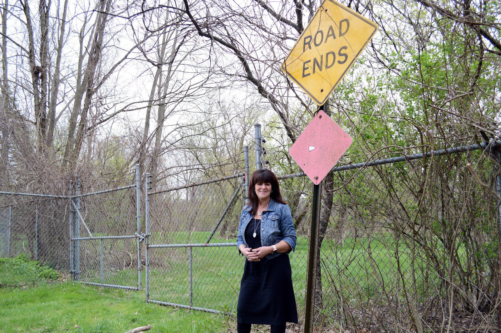 Galesburg mayor Lori West in the spring of 2019, standing were the KRVT was planned to go onto land near the Kalamazoo River.