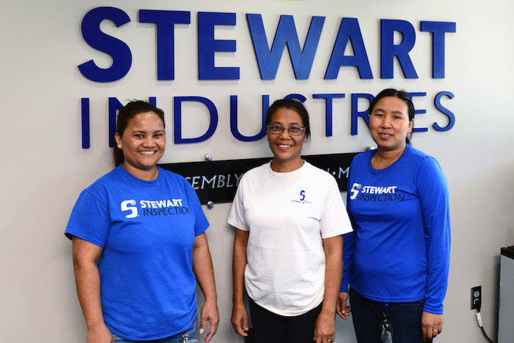 Tluang Hnem, Remh Thanzam and Vung Cing are three of seven Burmese refugees employed at Stewart.