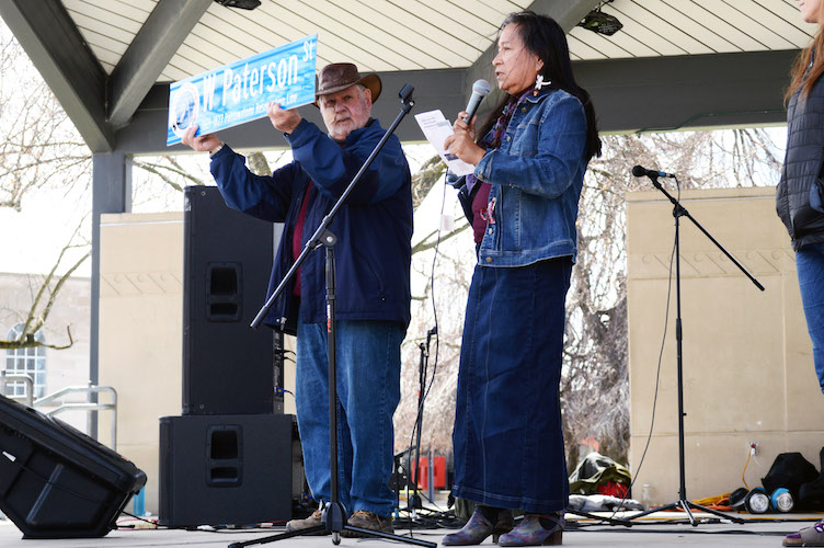 Historian and co-chair of the Kalamazoo Reservation Public Education Committee, and Phyllis Davis, Gun Lake tribal council member, reveal the 1821-1827 Pottawatomi Reservation Line at Bronson Park's Earth Day celebration, April 20.