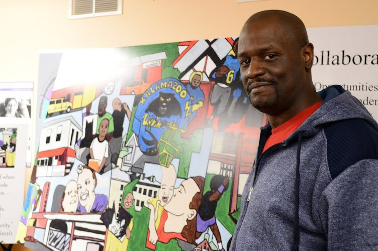 "Artist Gerald King with his ""Memories of the Eastside."""