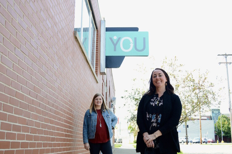 From left, Molly Fitz Henry, YOU manager of special initiatives, and Paige Daniels, YOU director, outside of YOU's Kalamazoo offices.