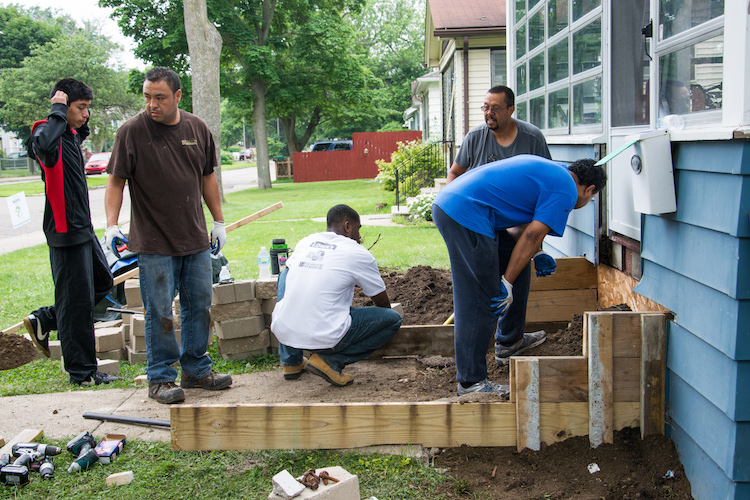 Residents work together on a recent Building Blocks project on Lane Boulevard.