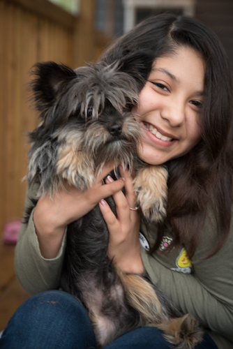 Esto's daughter, Nila, with the family dog. Photo by Fran Dwight.