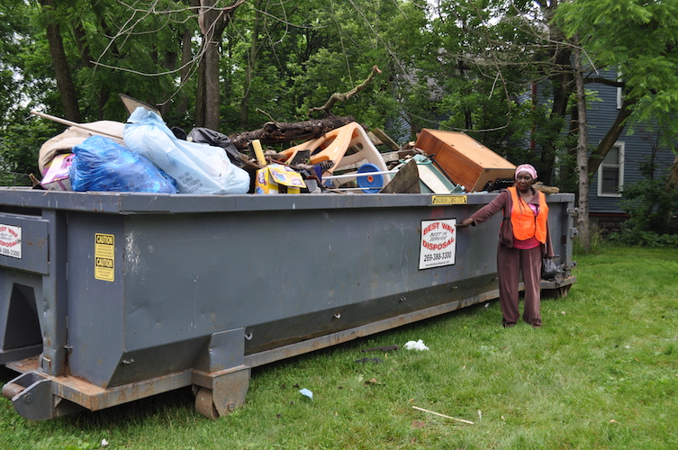 A dumpster full of items collected in Ada Street cleanup.
