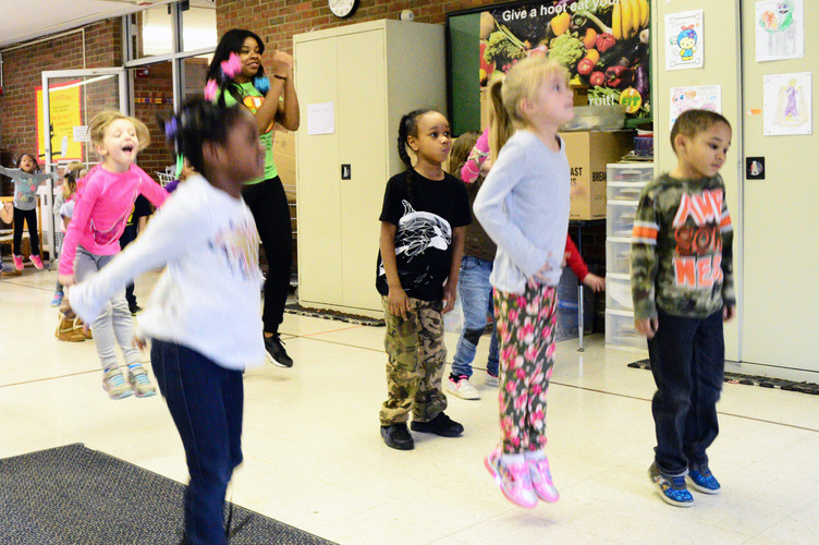 "Emirrora Austin helps LaMora kindergarteners ""shake their sillies out."" Photo by Mark Wedel"
