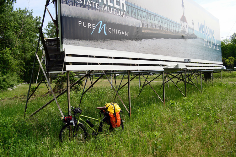 Bike's-eye-view of Pure Michigan billboard meant for I-94 drivers who've just crossed over from Indiana.