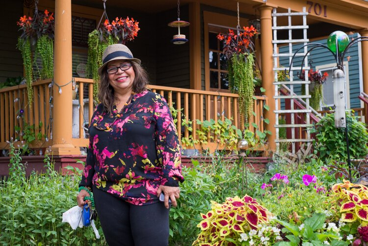 Martha Gonzalez' home on Cedar Street is a car-stopper with its vibrant gardens and welcoming porch.